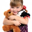 Stock Photo: Girl embracing favorite toys