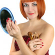 Stock Photo: Womwith red hair, apply makeup
