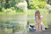 Young girl in a boat on the river — Stock Photo