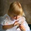 Butterfly girl stroking — Stock Photo