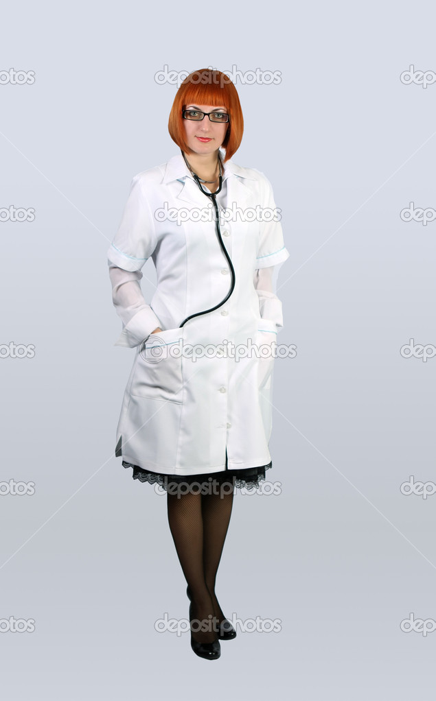 Woman doctor in a white coat — Stock Photo © ashka1978 2045153