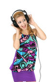 Girl in a bright dress with headphones — Stock Photo