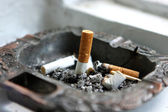 Ashtray with cigarettes extinguished — Stock Photo
