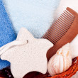 Foot stone and towels in basket - 