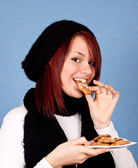 Cute girl eating cookies — Stock Photo