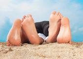 Couple Playing on the sand with feets — Stock Photo