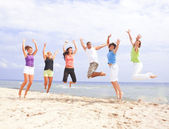 Happy jumping on the beach — Stok fotoğraf