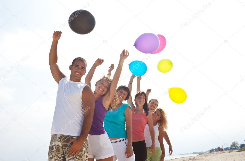 Happy young with balloons in nature — Stock Photo #1856079