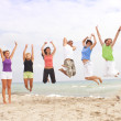 Happy jumping on the beach — Stock Photo