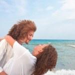 Loving couple having fun on the beach — Stock Photo
