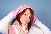 Portrait of girl in pink scarf and hat — Stock Photo