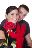 Smiling couple and one red rose — Stock Photo