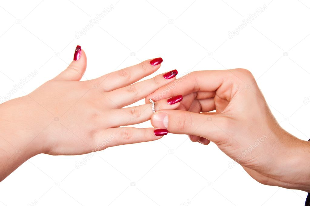 Man putting silver  ring on female hand — Photo #1966590