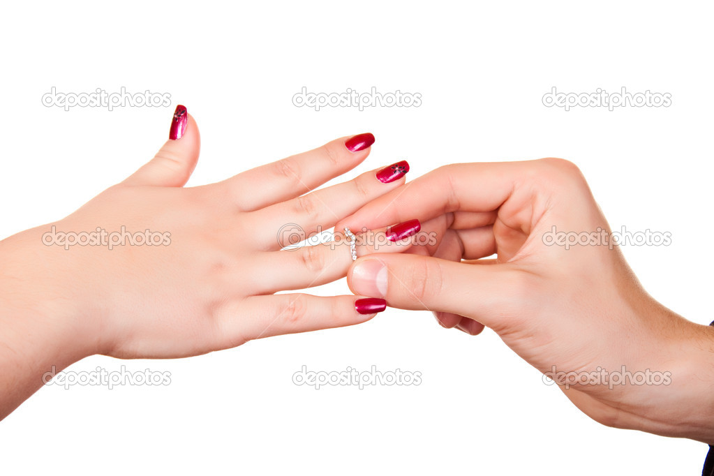 Man putting silver  ring on female hand — Stok fotoğraf #1966590