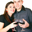 Smiling couple with red wine — Stock Photo