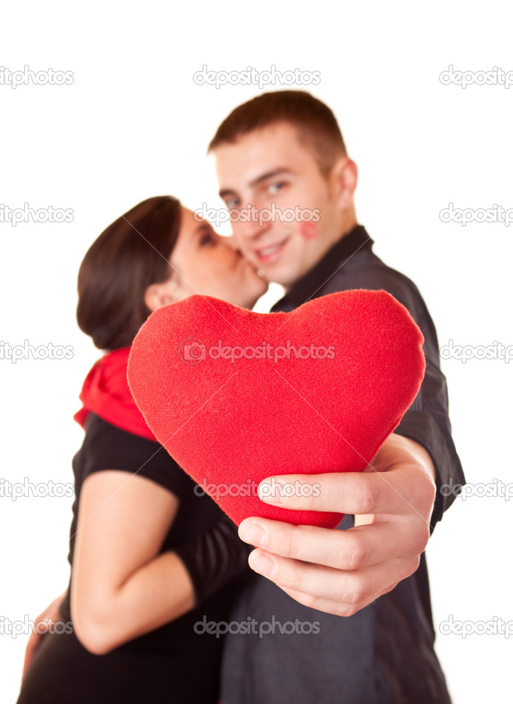 Young smiling couple holding a heart shape  Stock Photo #2026796