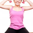 Girl in pink exercising with weights — Stock Photo