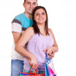 Happy couple with shopping bags — Stock Photo