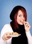 Girl eating cookies — Stock Photo
