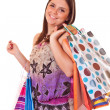 Happy young woman with bags — Stock Photo #2450022