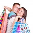 Stock Photo: Couple holding shopping bags