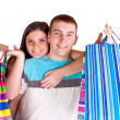 Smiling couple with shopping bags — Stockfoto