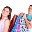 Girl is happy while man carrying bags — Stock Photo