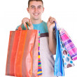 Man with colorful shopping bags — Stok fotoğraf