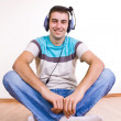 Man on the floor listening  music — Stock Photo