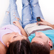 Young couple lying on the floor — Stock Photo #2450451