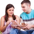 Stock Photo: Couple sitting on the floor and eating
