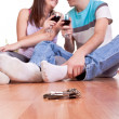 Keys and young couple on the floor — Stock Photo