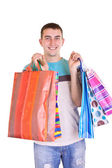 Man with colorful shopping bags — Stock Photo