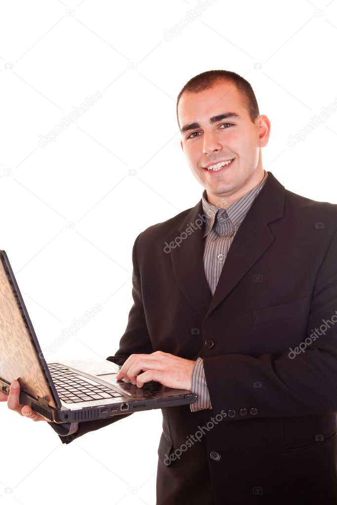Young attractive businessman standing in black suit holding laptop — Stock Photo #2450657