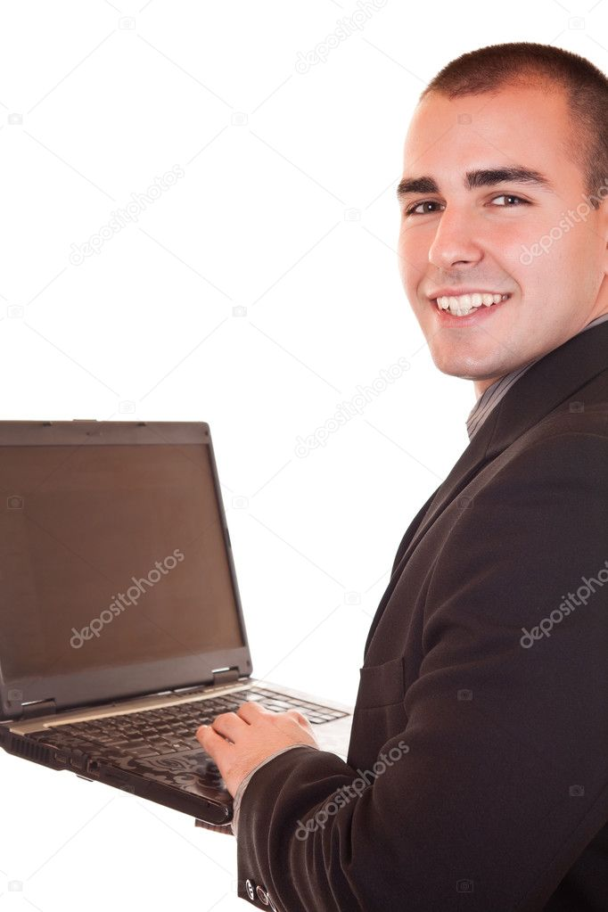 Young attractive businessman in black suit holding laptop and smiling — Stock Photo #2450676