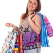 Smiling girl with colorful shopping bag — Stock Photo