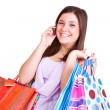 Stock Photo: Happy girl with bags and phone