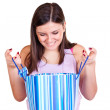 Looking into shopping bag — Stock Photo