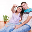 Couple showing keys to new apartment — Stock Photo #2541762