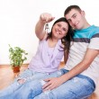 Stock Photo: Couple showing keys to new apartment