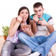 Couple on the floor  eating — Stock Photo