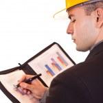 Businessman with helmet writing — Stock Photo