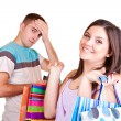 Man with wallet and woman with bags — Stock Photo