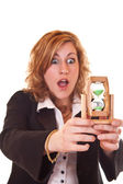 Businesswoman holding hourglass — Stock Photo