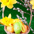 Colorful easter eggs in basket - Stock Photo