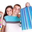 Young couple with shopping bags — Stock Photo #2626504