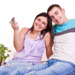 Young couple wiht keys in new apartment - Stockfoto
