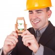 Young engineer with hourglass — Stock Photo