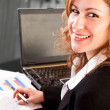 Close-up of businesswoman in office - Stock Photo