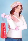 Winter girl with shopping bag — Stock Photo